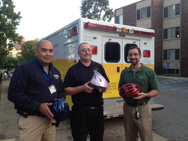 Volunteers from AGH and West Penn's STAR center fitted helmets.