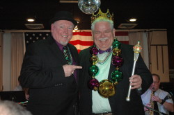 Photo by Justin Criado Former Mardi Gras King Jack Hunt (left) hands the crown and scepter to Rick Sebak