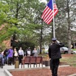 Elected officials, Honor Guard and residents salute the American flag during Sept. 1, 2017 flag raising ceremony at Steelworkers Tower plaza in Brighton Heights. Photo credit: Neil Strebig