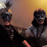 Brighton Heights residents Carol Nayman and Marinne Stack wear celebatory masks during the Northside Mardi Gras celebration. Photo credit: Neil Strebig