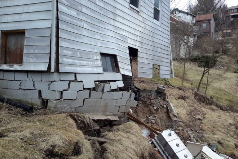 Condemned Northside home collapses as result of landslide damage