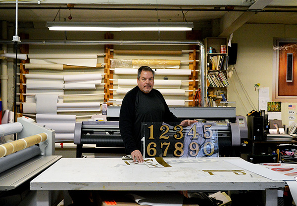 Century-old sign company has true grit